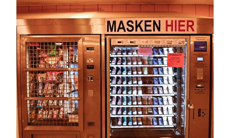 Face masks are sold in a vending machine in a Berlin subway station