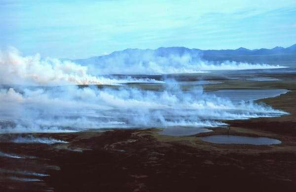 Heat waves, wildfire & permafrost thaw: The North's climate change trifecta