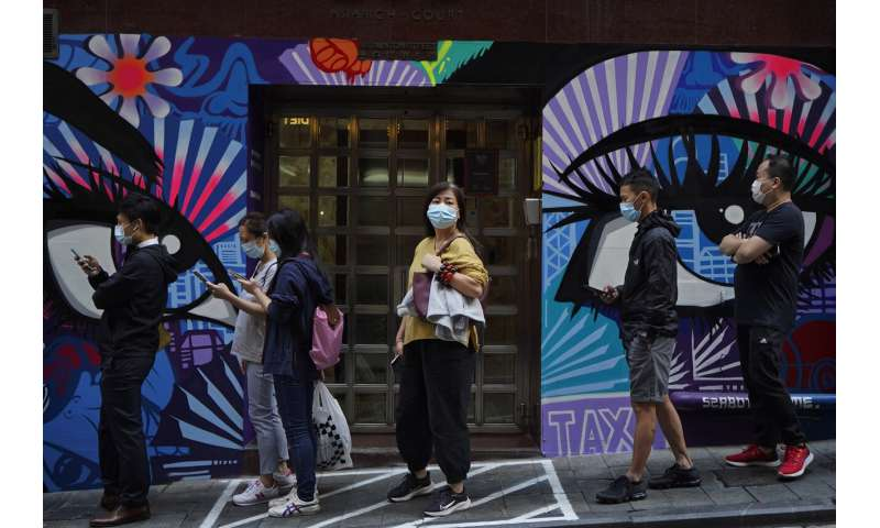 Hong Kong leader urges people to stay home as cases rise