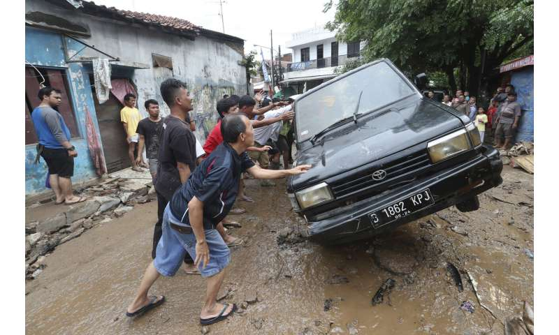 Indonesian capital reels from floods that leave 47 dead