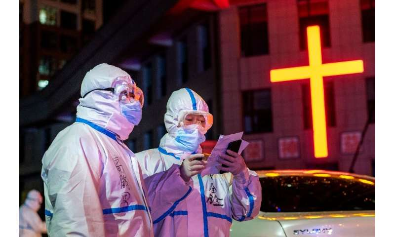Medical workers in China's northeastern Heilongjiang province conduct coronavirus contact tracing