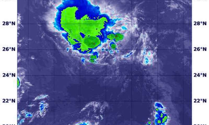 NASA finds Post-Tropical Low Douglas crossing a line