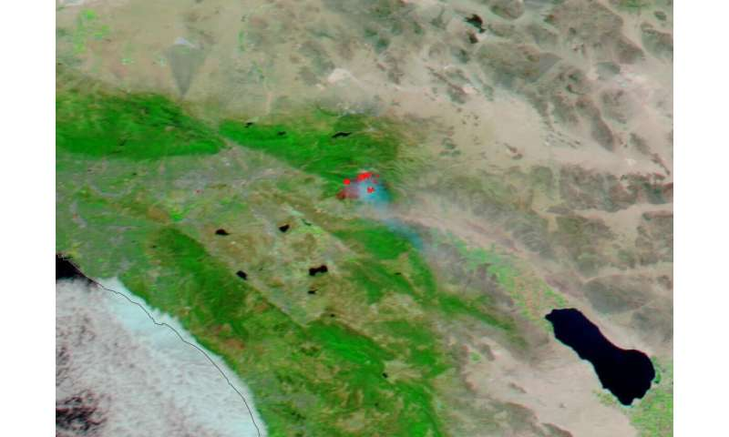 NASA's Aqua satellite shows two views of the apple fire