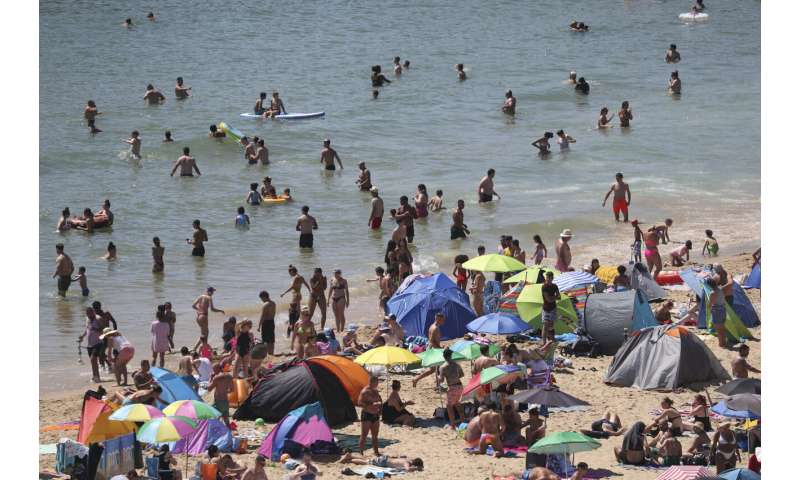 On hottest day of year, thousands cram onto English beaches