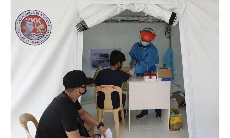 Philippine capital returning to lockdown as virus surges