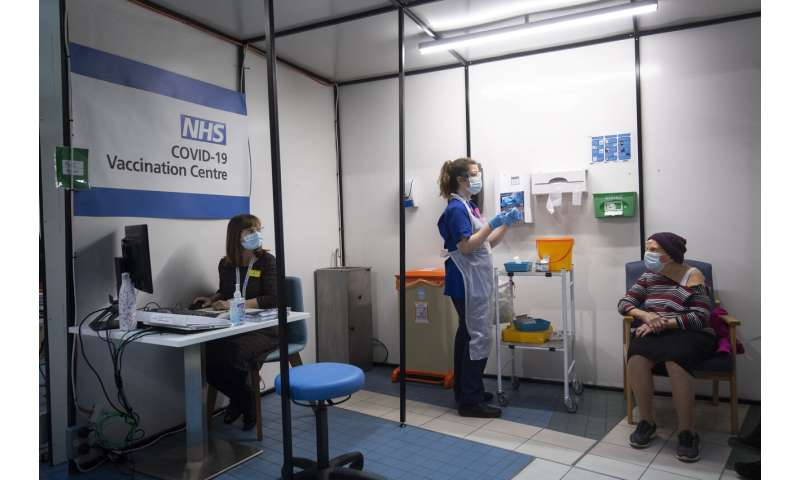 'Route out' of pandemic: UK gives 1st COVID-19 vaccine doses