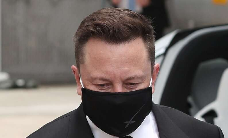 SpaceX founder Elon Musk wears a face mask while attending the walkout of NASA astronauts Bob Behnken and Doug Hurley at the Ken