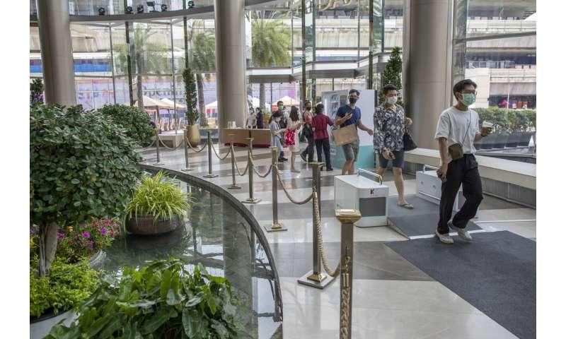 Thailand malls reopen, with temperatures taken, masks worn