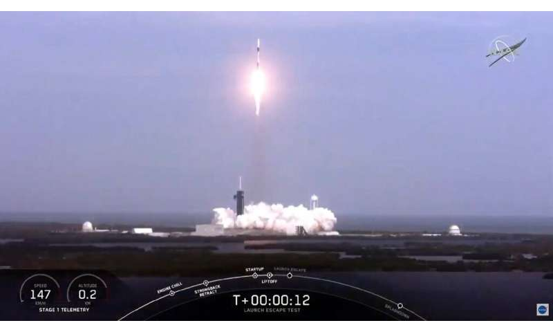 This NASA TV video frame grab shows a SpaceX rocket launching to perform an in-flight abort test of its Crew Dragon spacecraft,