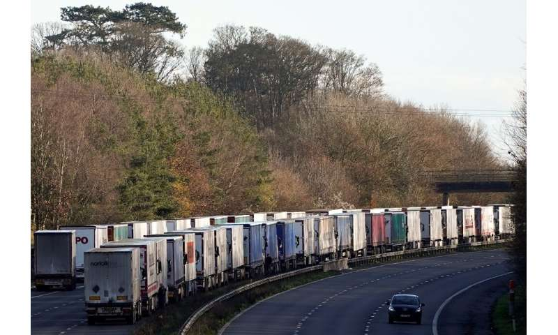 Thousands of trucks were backed up on motorways in southern England on Christmas Day even after France reopened border crossings