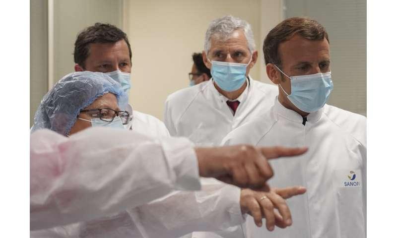 UK begins coronavirus vaccine trial; France pledges funding