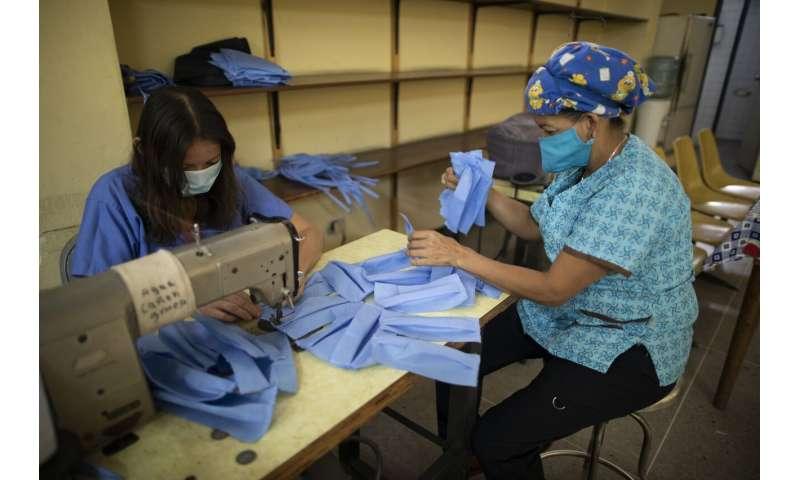Venezuela hospital makes its own masks to confront new virus