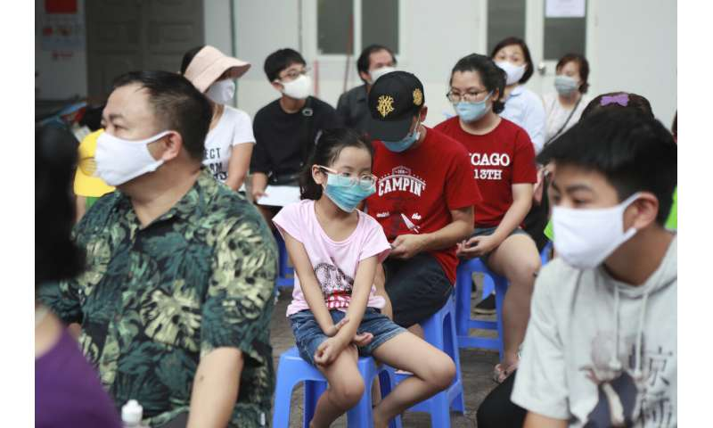 Vietnam reports 1st ever virus death after renewed outbreak