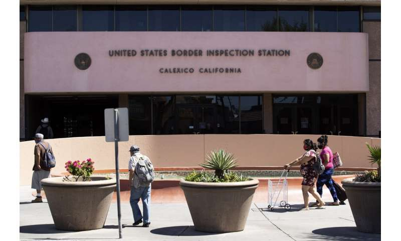 Virus cases spike in California county on Mexican border