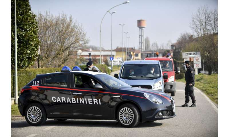 Italy tries to contain virus as isolated towns hunker down