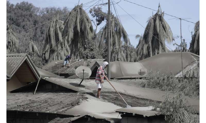 Philippine volcano trembles more, spews lava half-mile high