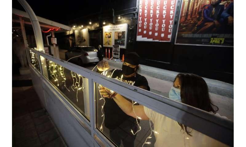As lockdowns ease, health officials urge virus vigilance