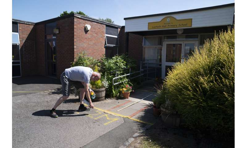 Britain divided over reopening schools as virus rules ease