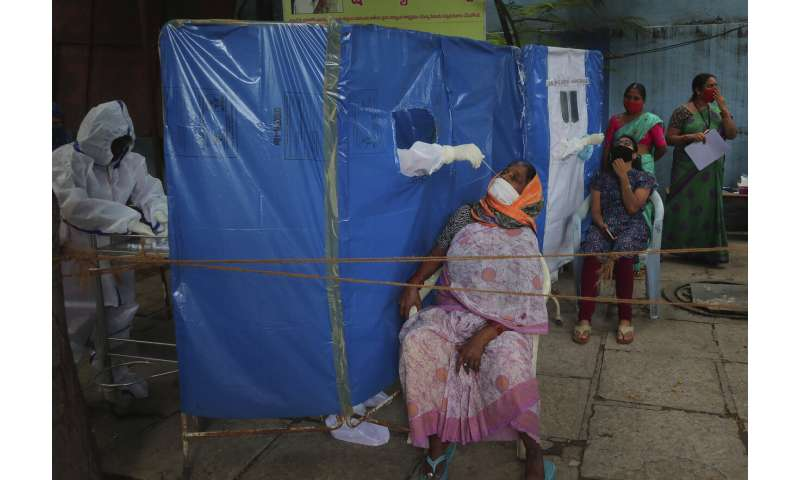 India's virus caseload tops 3 million as disease moves south