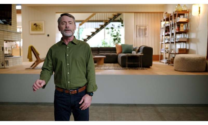In this photo released by Apple, Apple's vice president of Worldwide Product Marketing Bob Borchers speaks about the HomePod min