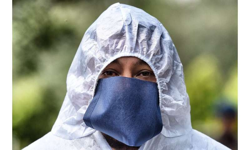 Latin America has now suffered at least 70,000 dead from the coronavirus outbreak and in Mexico funeral workers wear full protec