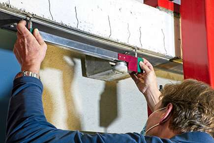 Study of long-term behavior of bonded steel reinforcements on a concrete beam enters 50th year