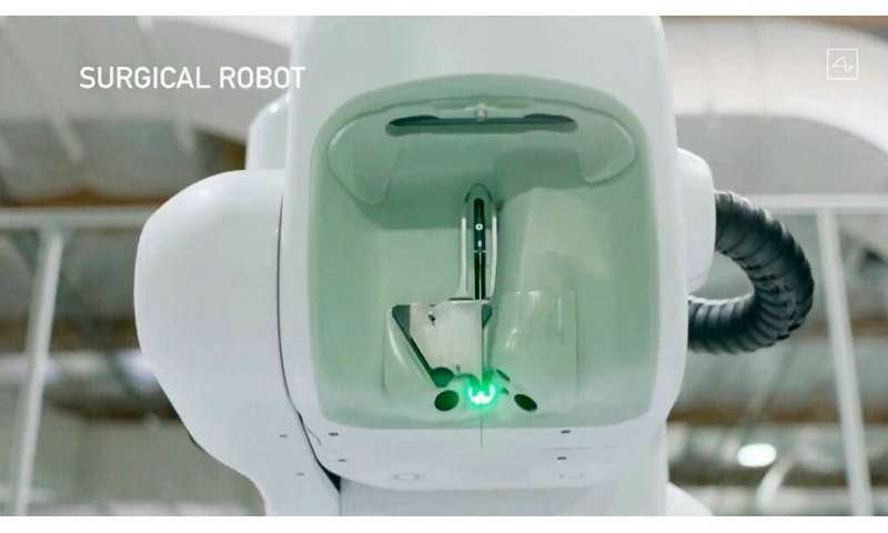 This video grab made from the online Neuralink livestream shows the surgical robot during Elon Musk's Neuralink presentation on