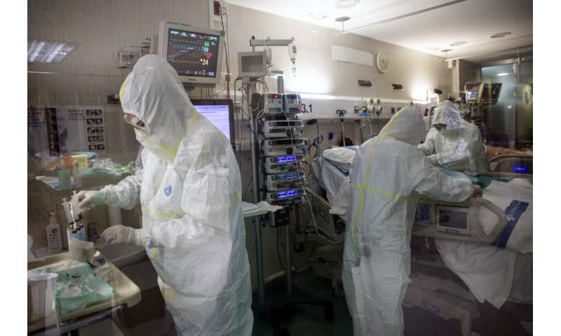 With more infections than China, Spain tightens lockdown