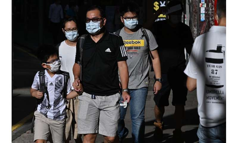 Authorities in Hong Kong made it mandatory to wear masks in public from this week and unveiled the city's toughest social distan