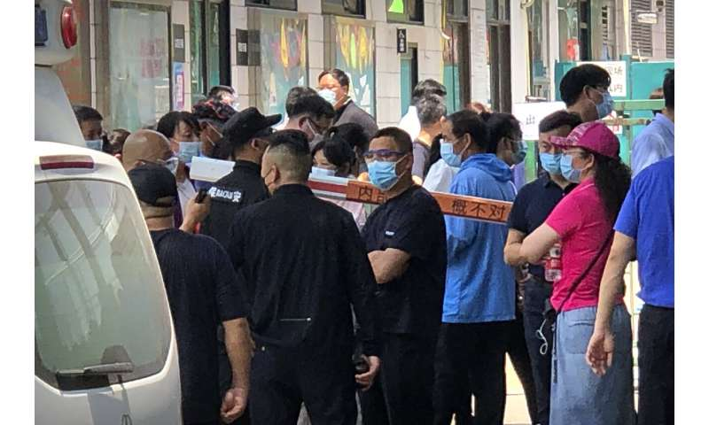 Beijing expands lockdowns as cases top 100 in new outbreak