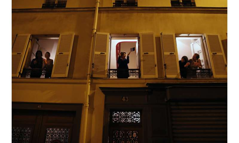 Europeans sing health workers' praises nightly from windows