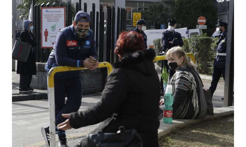 Italy extends partial lockdown as Naples hospitals struggle