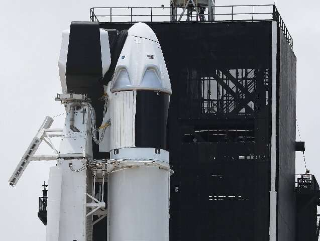 The Crew Dragon capsule atop SpaceX's Falcon 9 rocket