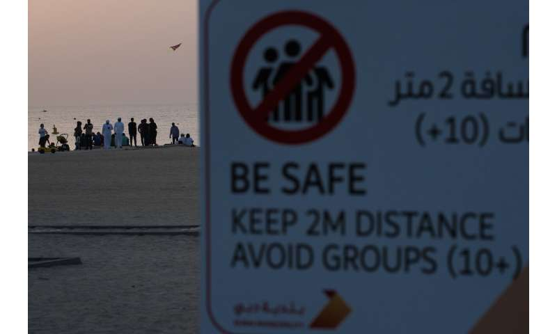 Travel hub UAE to halt flights as virus reaches Gaza, Syria