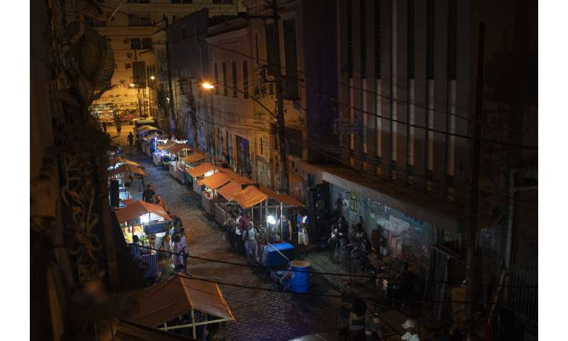 Brazil strains at quarantine as virus cases pass 5 million