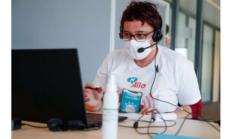 Contact tracing for infectious diseases has been traditionally done by people in call centers such as this one  in Brussels in a