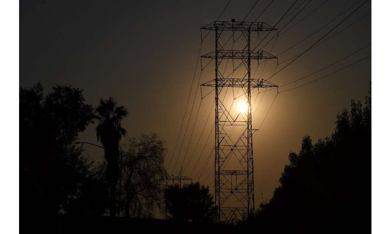 Electrical power lines are seen in Los Angeles on August 19, 2020 during a triple-digit heatwave