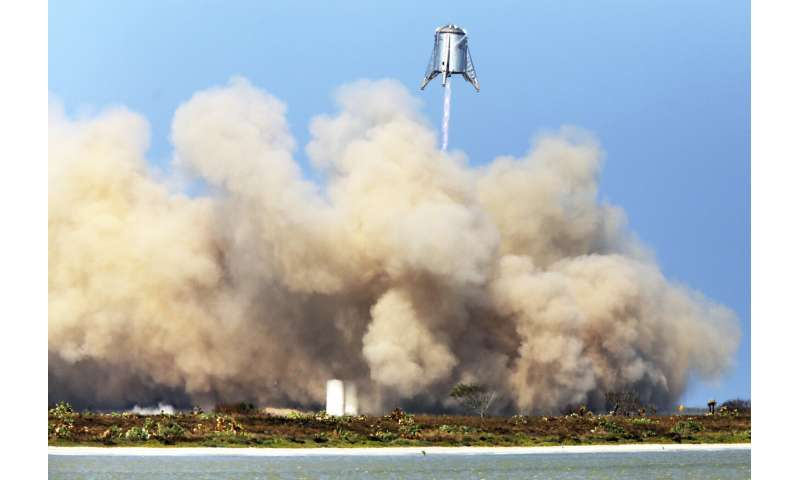 First commercial space taxi a pit stop on Musk's Mars quest