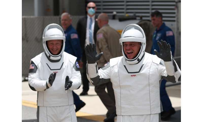 NASA astronauts Bob Behnken (R) and Doug Hurley (L)
