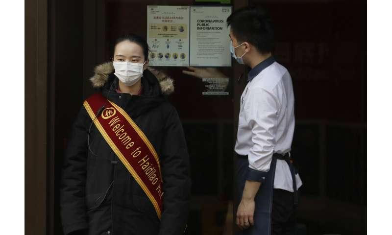 Spain confirms 2nd virus case; UK plane brings 200 evacuees
