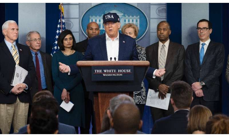 US President Donald Trump (C, pictured with members of the Coronavirus Task Force at the White House) reportedly is trying to po