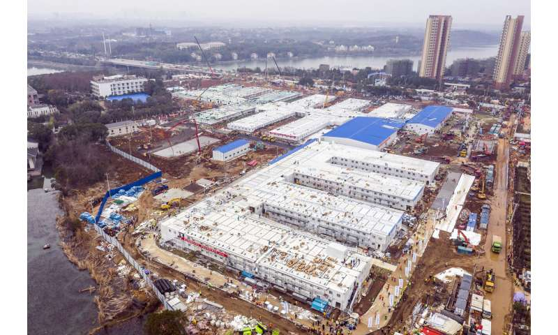 Built in 10 days, China's virus hospital takes 1st patients