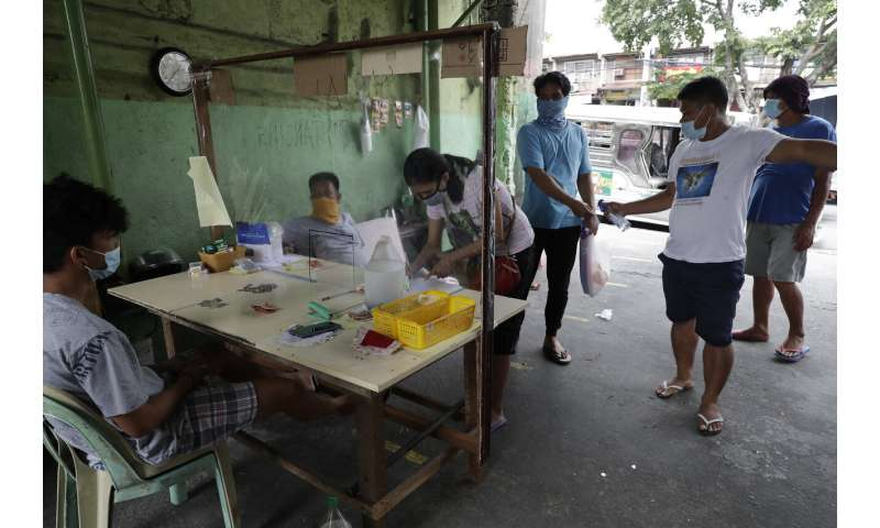Philippines virus cases top 100,000 in 'losing battle'