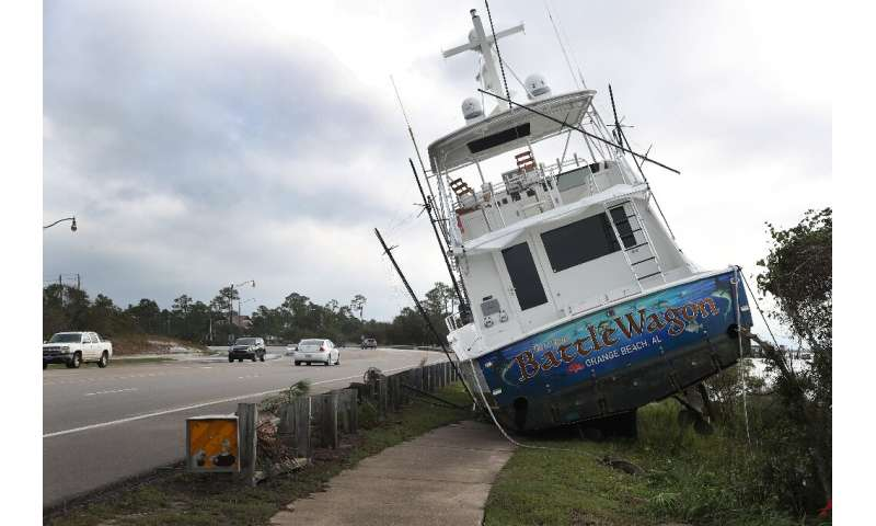 A boat registered in Orange Beach, Alabama, washed ashore after Hurricane Sally