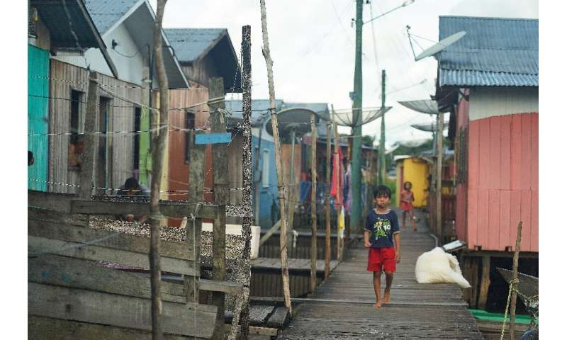 A boy walks through the town of Carauari, where residents fear the reach and spread of the coronavirus COVID-19 pandemic in the