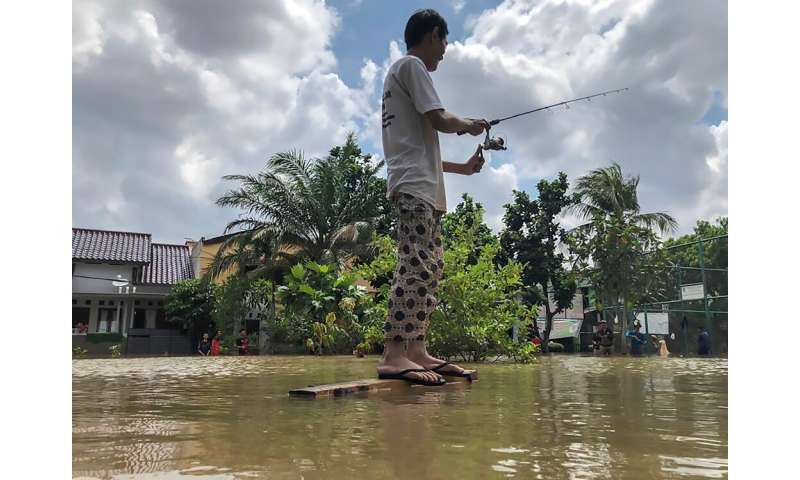 Across the city, kids took the opportunity to swim in the floodwaters while some people grabbed fishing rods