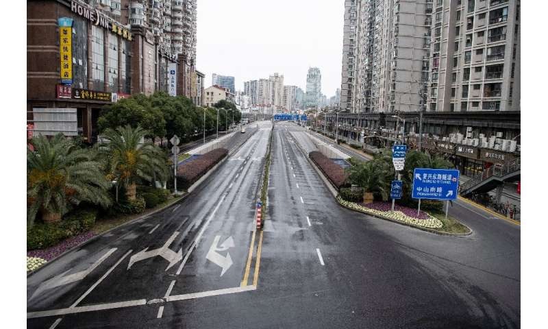 A deserted street in Shanghai, as fear of the spread of the virus impacts cities across China, even those not in lockdown