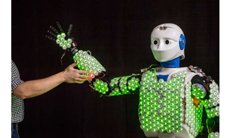 A highly performing and efficient e-skin for robotic applications