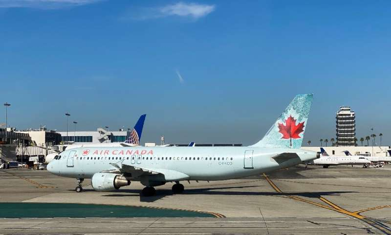 Air Canada is planning temporary layoffs of roughly half its 10,000 flight attendants, their union says