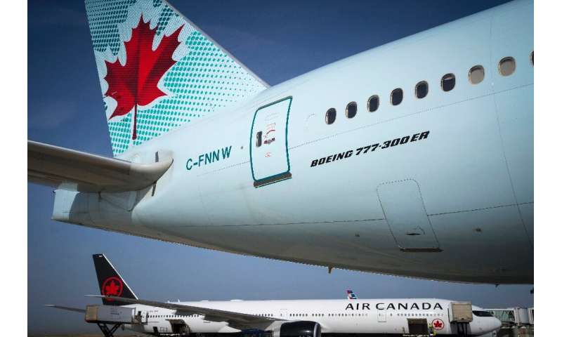 Air Canada says it will rehire furloughed employees under a government relief program
